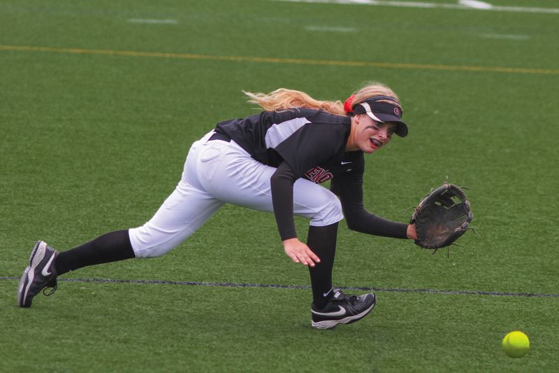 by: HILLSBORO TRIBUNE PHOTO: CHASE ALLGOOD - Glencoe senior shortstop Courtney Clayton tracks a ground ball during last Wednesday's 2-1 victory over Aloha in the Class 6A state playoffs.