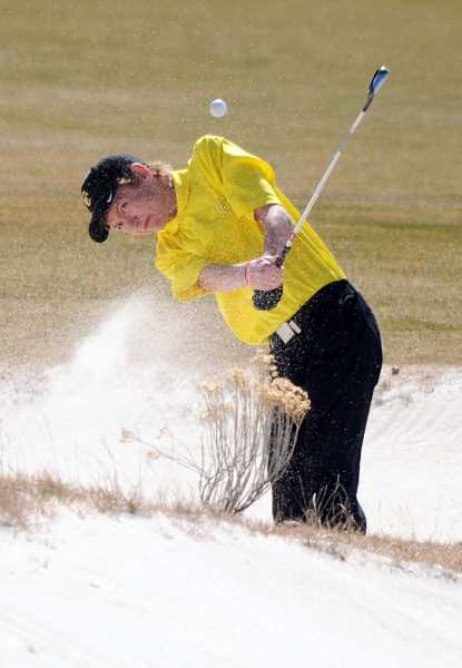 by: CENTRAL OREGONIAN FILE PHOTO - Kody Kuk plays out of a bunker at Brasada Ranch Golf Course early in the year. Kuk was one of the Cowboys' top golfers this year and had a career-best round of 75 at Broken Top Golf Course later in the season.