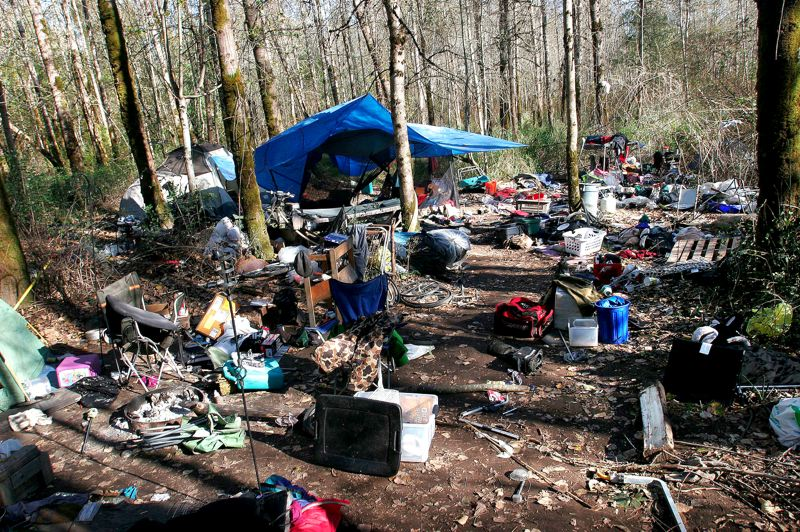 by: OUTLOOK FILE PHOTO: JIM CLARK - Transients amass piles of stuff at a campsite deputies found in Thousand Acres last fall.