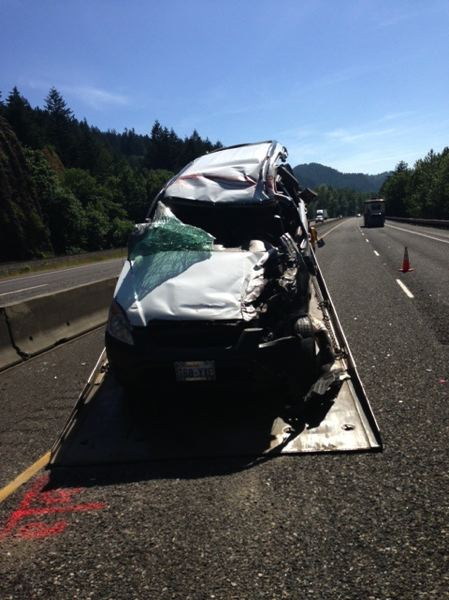 by: CONTRIBUTED PHOTO - A 71-year-old Washington woman was trapped in her car after it rolled and landed on its side on Interstate 84.