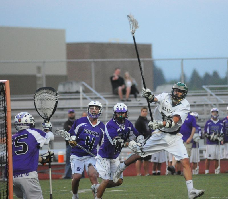 by: MATTHEW SHERMAN - West Linn's Colin Squires winds up for a shot that would find the back of the net in the second half of the Lions' victory over Sunset last week. The win propelled West Linn into a semifinal match-up with Jesuit Wednesday.