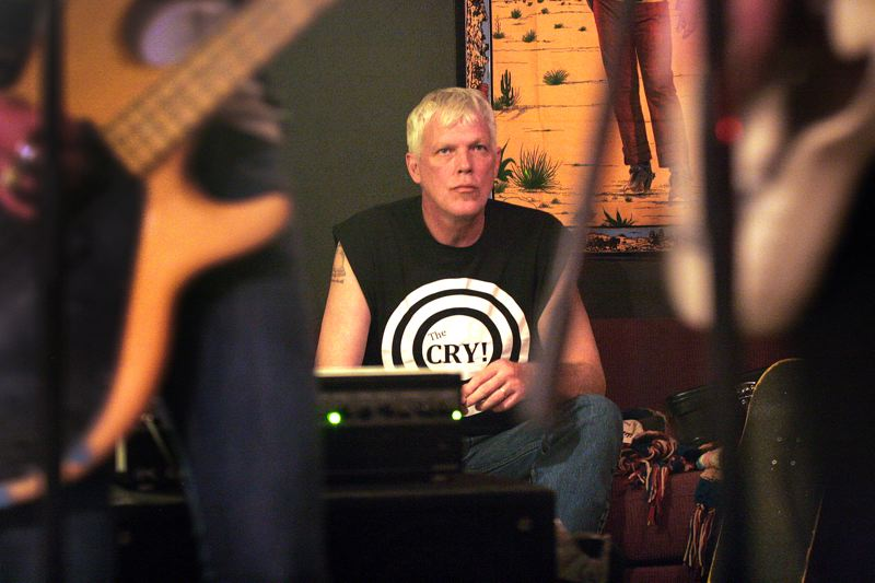 by: JIM CLARK - John Nelsen gives a listen to The Cry as they prepare to play the Portland Rose Festival Saturday, June 7.