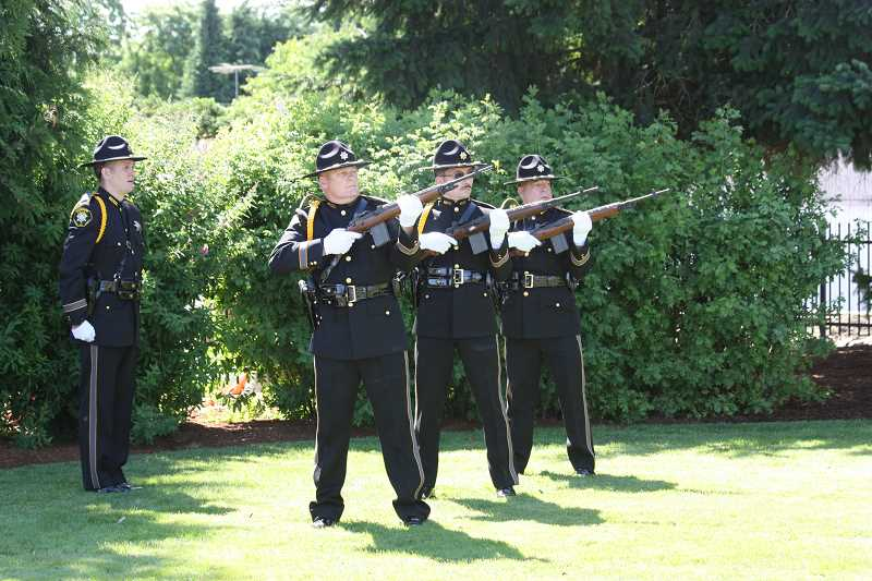 by: HILLSBORO TRIBUNE PHOTO: DOUG BURKHARDT -  The Washington County Sheriff's Office Honor Guard presented a gun salute to U.S. Army Specialist John A. Pelham at Veterans Memorial Park in Cornelius on Saturday. Pelham, a soldier from Beaverton, was killed in action in Afghanistan in February. About 150 people turned out to pay tribute to Pelham's service and sacrifice.