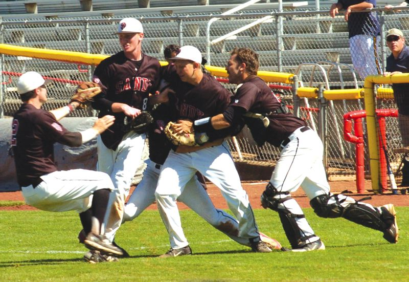 by: SANDY POST: PARKER LEE - Sandy players swarm Austin Carson after his game-ending catch.