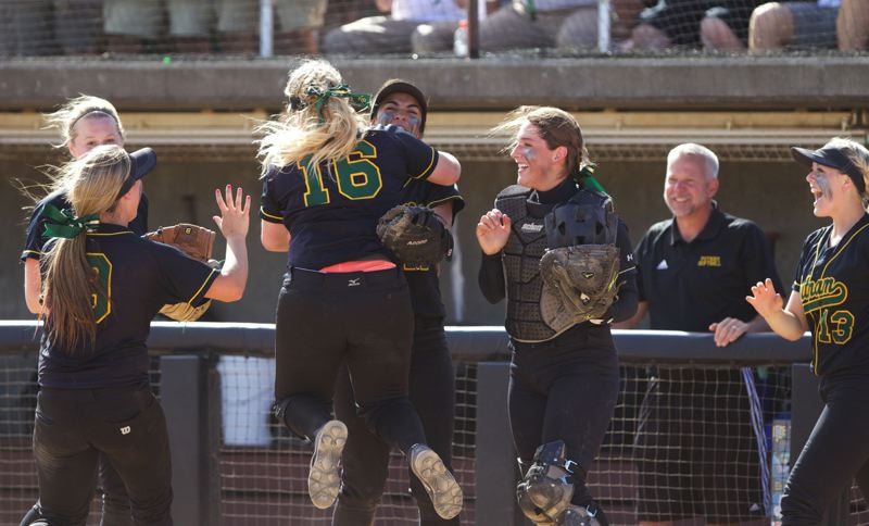 by: JAIME VALDEZ - Teammates greet Maggie Waymire (16) after the Rex Putnam junior third baseman completed a double play to close out the fifth inning of Saturdays Class 5A state final, contested Saturday at the Oregon State University Softball Complex.
