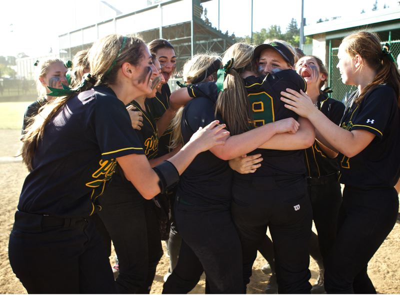 by: JAIME VALDEZ - Putnam players celebrate their hard fought state playoff semifinal win over Northwest Oregon Conference co-champion St. Helens.
