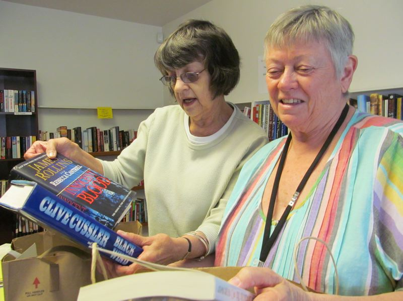by: PHOTO BY ELLEN SPITALERI - Peg Tarbox, left, sorts books with Nikki Hoff, as they prepare for the upcoming Friends of Ledding Library Book Sale. They are still accepting book donations for the event.