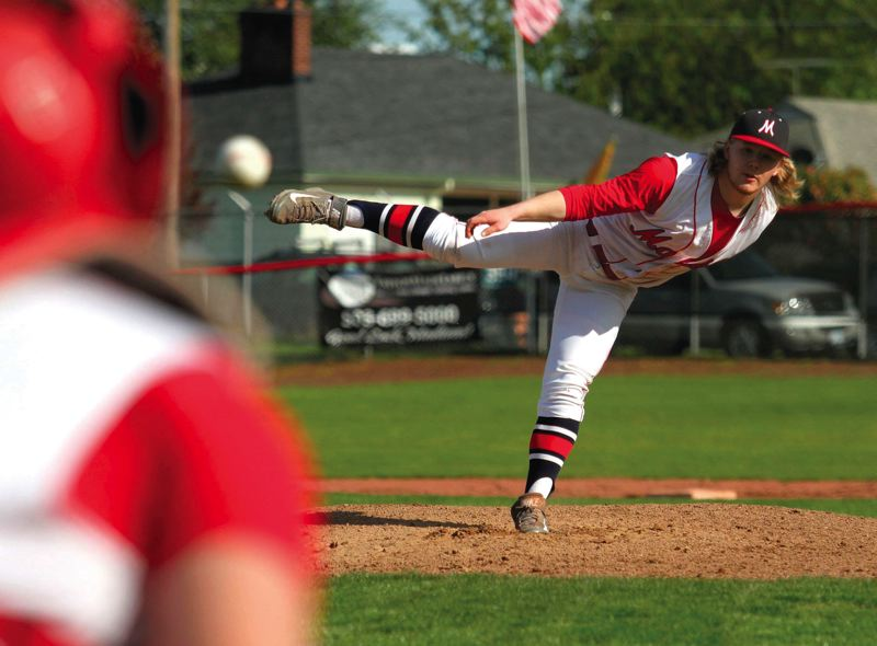 by: TRIBUNE PHOTO: JONATHAN HOUSE - Robby Heiberg delivers a pitch during a home game for Madison during the Portland Interscholastic League season. Heiberg is now one of several players from Madison and other local schools on the successful AAA American Legion team, the Barbers.