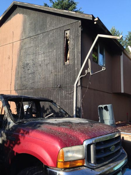 by: TUALATIN VALLEY FIRE & RESCUE - A pile of oily rags spontaneously combusted in the back of this pickup truck on Friday evening, creating a fire that spread to the house it was parked next to.