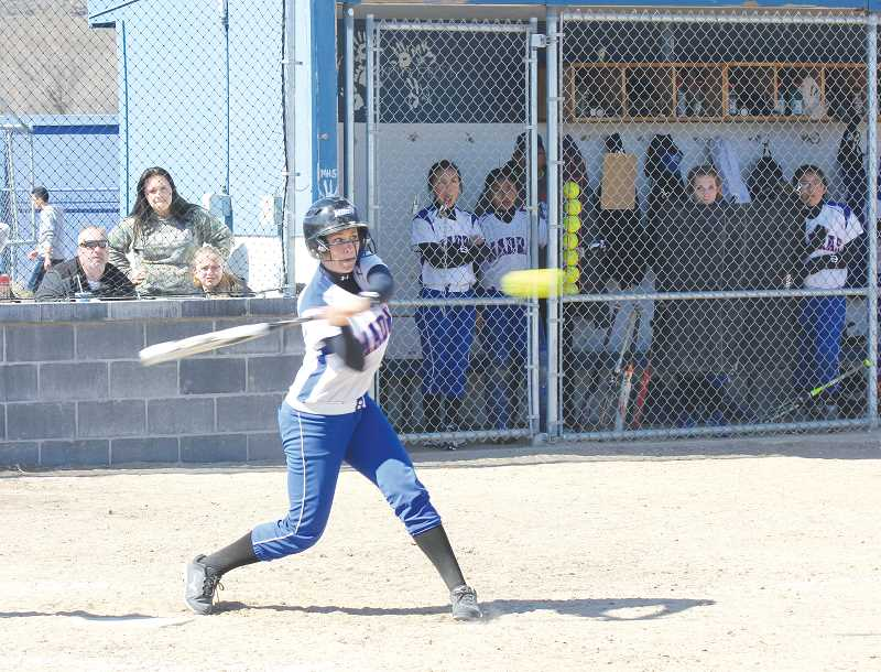 by: JEFF WILSON/THE PIONEER - Junior shortstop Shelby Mauritson carried a big bat for the White Buffalos this fastpitch season.