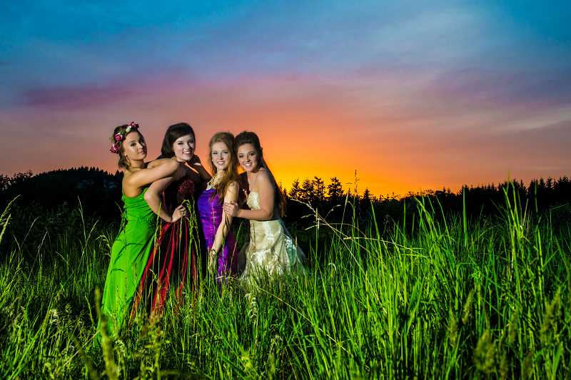 by: SUBMITTED PHOTO: KELLY MOONEY PHOTOGRAPHY - The models for the Disney Princess shoot included from left Kennedy Grant as Belle from the Beauty and the Beast; Xandria Lewis as TInkerbell from Peter Pan; Cassie Whiteley-Ross as Ariel from The Little Mermaid and Kelly Schoenborn as Snow White from Snow White and the Seven Dwarfs.
