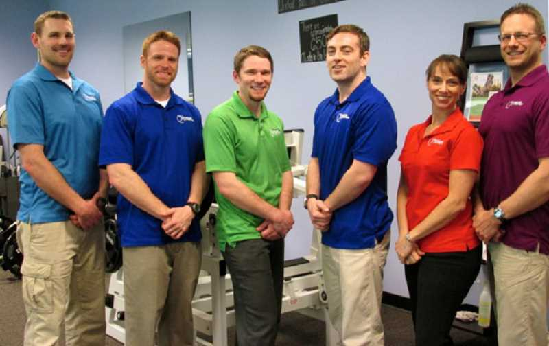 by: SUBMITTED PHOTO:  - Pictured from left are Muscles in Motion strength coaches and professional personal trainers Greg Burnett, Alex OFarrill, Patrick Long, Mark Lane and owners Diana Del Garbino and Matt Del Garbino.
