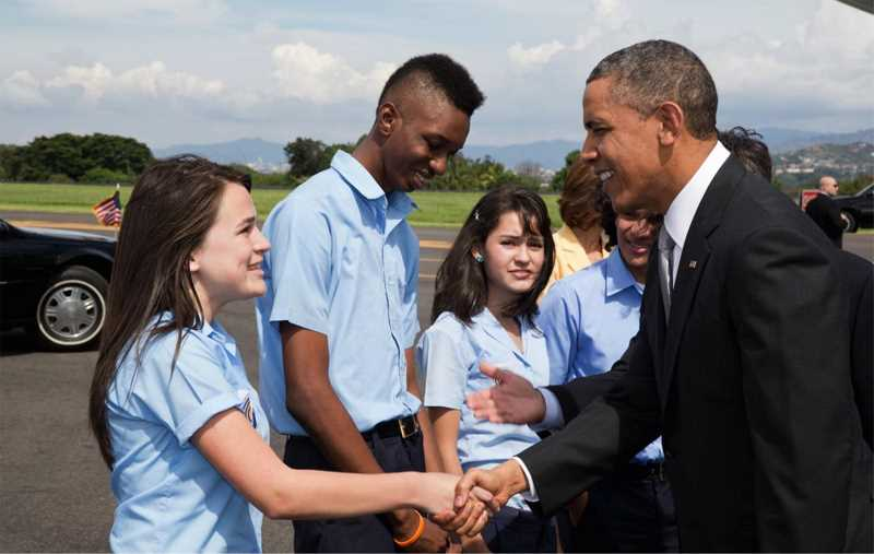 by: COURTESY PHOTO - Katy Fernandez got to meet President Barack Obama on her native Costa Rican soil before embarking on a nine-month exchange trip to Forest Grove in 2013-14.