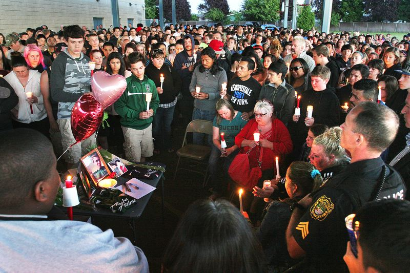 by: OUTLOOK PHOTO: JIM CLARK - Hundreds of people took part in the Walt Morey Middle School vigil for Emilio Hoffman who was shot and killed at Reynolds High School on Tuesday morning.