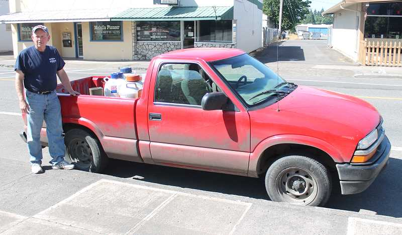 by: JIM BESEDA/MOLALLA PIONEER - Larry Hansen averages about 1,500 miles a week in his job as a cattle reproduction specialist and last week passed the 500,000-mile mark in his 2003 Chevy S-10, driving all those miles with the original motor.