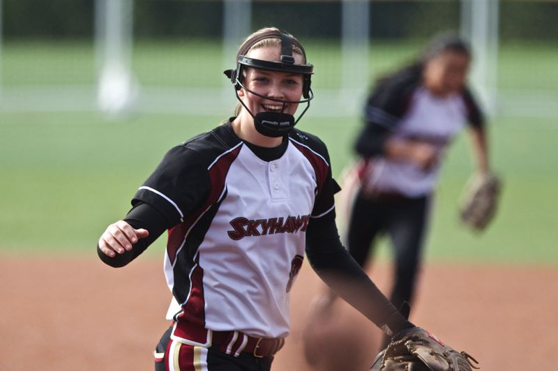 by: TIMES PHOTO: JAIME VALDEZ - Southridge sophomore starting pitcher Kalee Mabray celebrates the Skyhawks come-from-behind win over Central Catholic in the first round of the 6A playoffs.