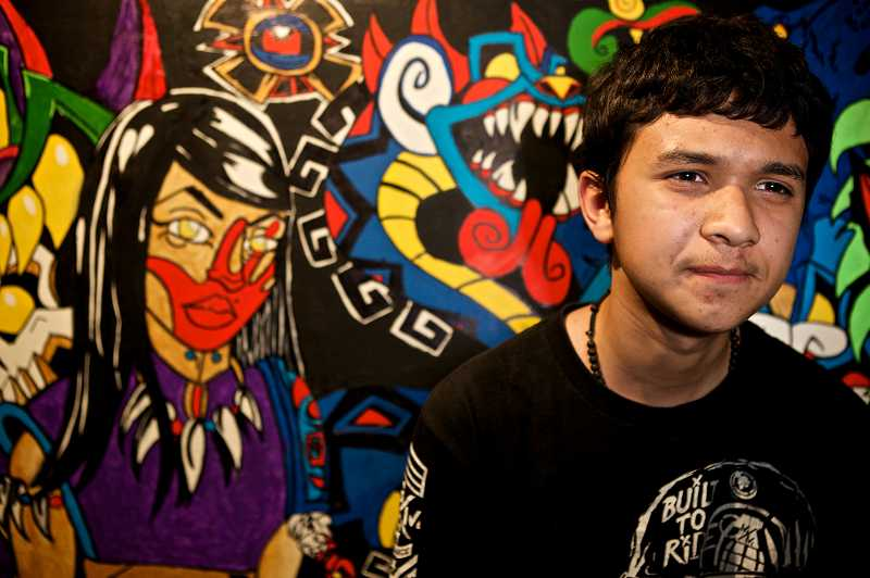 by: TIMES PHOTO: JAIME VALDEZ - Jacob Villanueva who is a freshman at Tualatin High School, stands in front of a mural he created he calls,  Mictlantecuhtli.