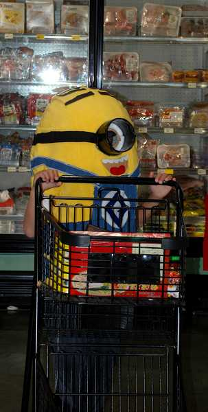by: TIMES PHOTO: KEITH SHEFFIELD - Hardworking Minions, from the popular movie 'Despicable Me,' helped with shopping duties while perusing Uwajimaya's aisles.