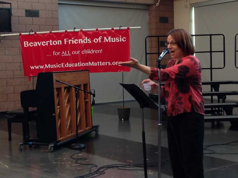 by: BEAVERTON FRIENDS OF MUSIC: JENNIFER MOHR - Beaverton Friends of Music co-founder Carolyn Talarr served as master of ceremonies at the launch celebration for the Beaverton Band Together program.