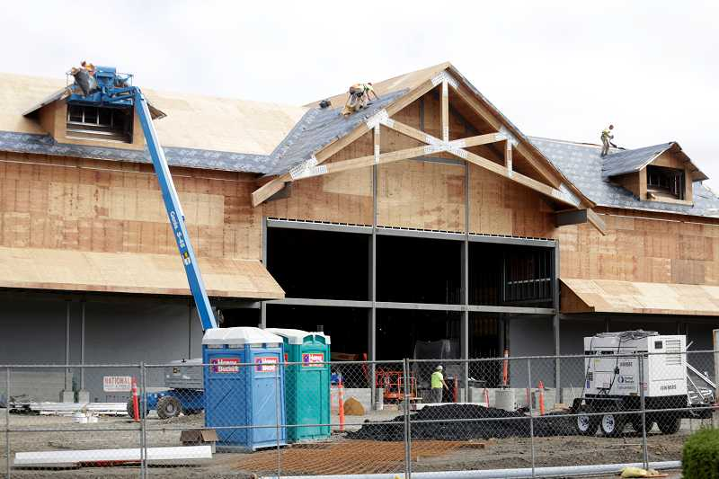 by: TIMES PHOTO: JONATHAN HOUSE - Work continues on the new Cabelas in Tualatin.