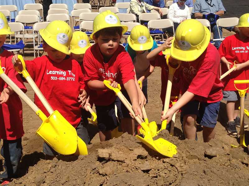 by: TIMES PHOTO: GEOFF PURSINGER - Preschool students from Learning Treet Schools on Southwest Milton Court help break ground at the new Bonita Pump Station next door to their school. The pump station is the backbone of the citys new water system, which is expected to open in 2016.