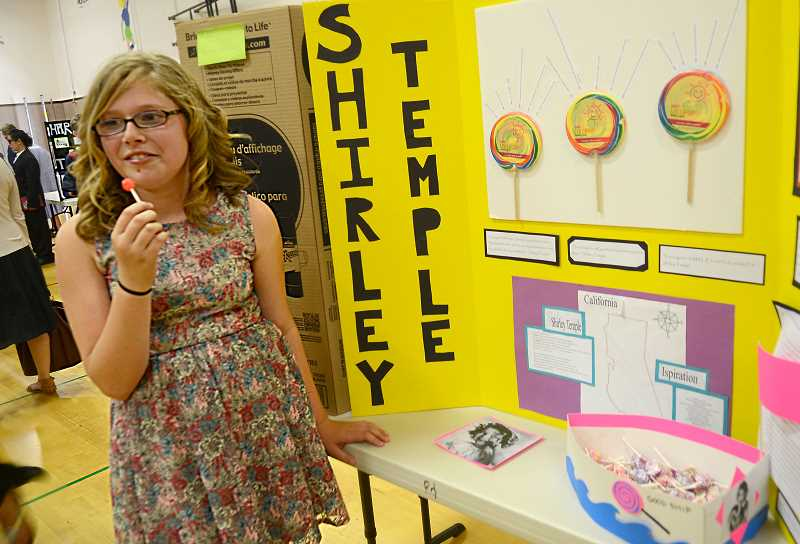 by: REVIEW PHOTO: VERN UYETAKE - Amaiya Lee puts together a presentation about Shirley Temple.