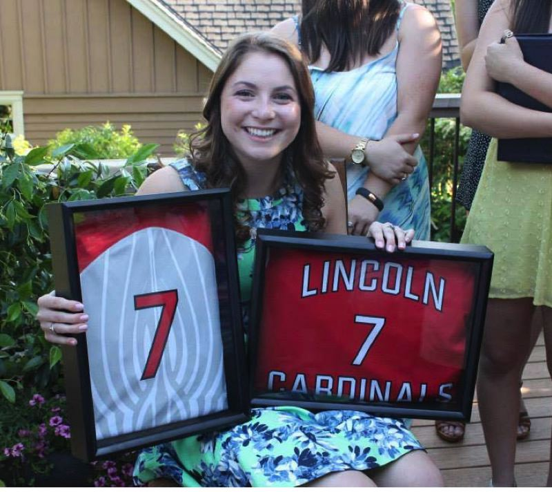 by: COURTESY OF SYDNEY MESHER - Lincoln High softball star PC Mesher, the PIL 6A player of the year, is surprised by the gift of a framed version of her No. 7 jersey.