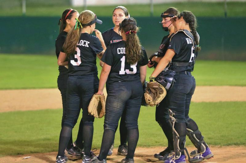 by: COURTESY OF PAGE MESHER - Lincoln High softball players (from left) Belle Odenthal, Morgan Portlock, PC Mesher, Jordan Coleman, Maggie Clapp and Lexi Washington gather at the mound during a 2014 game. Mesher earned PIL 6A player-of-the-year honors, capping a stellar four-year career in which she overcame numerous injuries and health challenges.