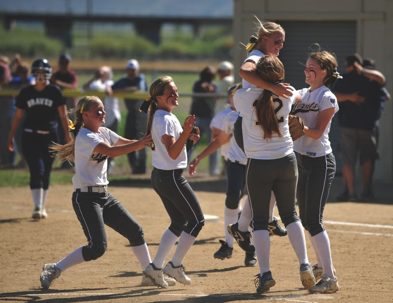 Henley softball players celebrate their 4-3 victory over Banks, the two-time defending state champions, in the semifinals of the Class 4A playoffs last Tuesday in Klamath Falls.