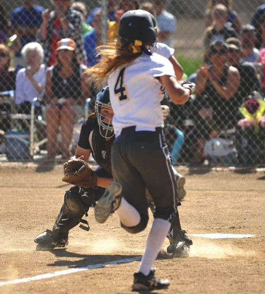 Banks catcher Madison Soper prepares to tag out Henley's McKenna Armantrout during last Tuesday's state playoff game.