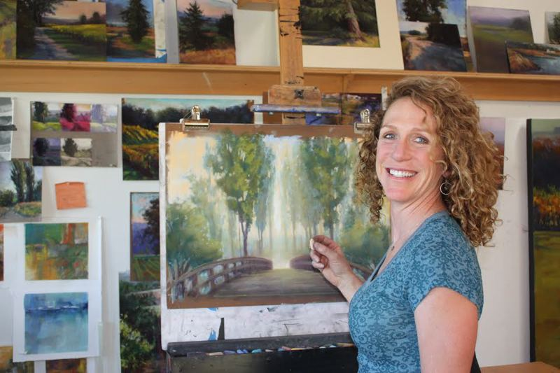 by: HILLSBORO TRIBUNE PHOTO: DOUG BURKHARDT - With works in progress adorning the walls all around her, Amanda Houston takes to her easel to create a new landscape. Inset: Houston has been painting a number of colorful portraits of birds lately.
