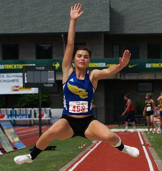 by: PHOTO COURTESY OF DOUG SMITH - Laken Berlin won the state championship in the long jump. The junior was also part of the Cowgirls third place 4x100-meter relay team.