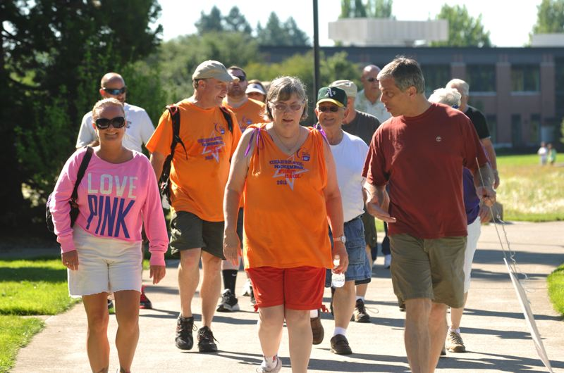by: SUBMITTED PHOTO - 2013 Relay walkers circle the course at Town Center Park.