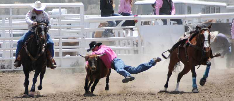 by: LON AUSTIN/CENTRAL OREGONIAN - James Beatty makes a run in steer wrestling. Beatty finished ninth in the event.