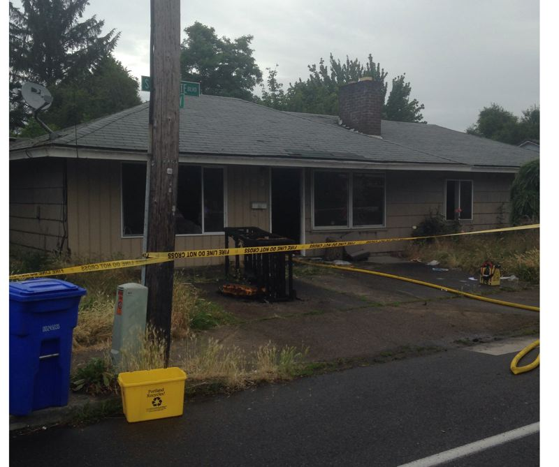 by: PORTLAND FIRE & RESCUE - A woman was critically injured in a fire in this house Monday morning.