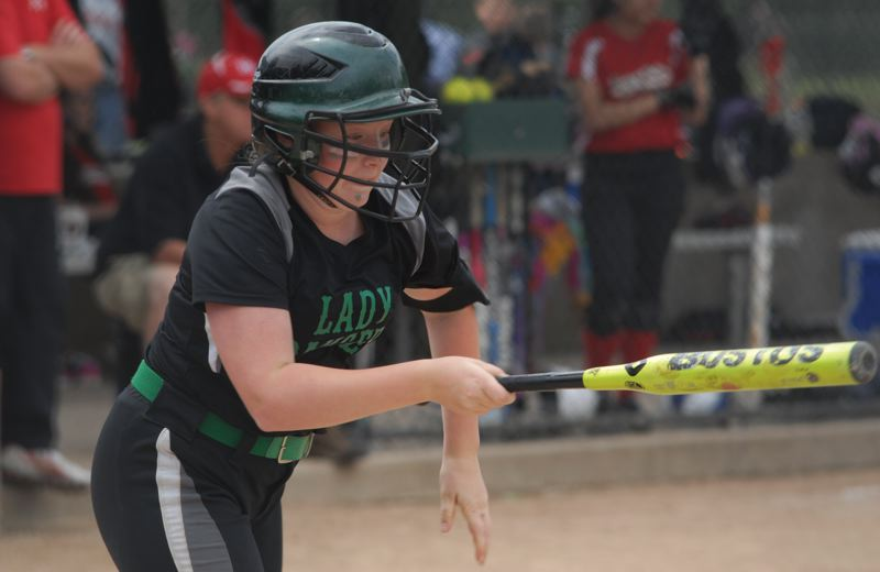 by: ESTACADA NEWS: DAVID BALL - Estacadas Allison Hartman heads down the first-base line after making contact during Sundays semifinal win over Happy Valley.