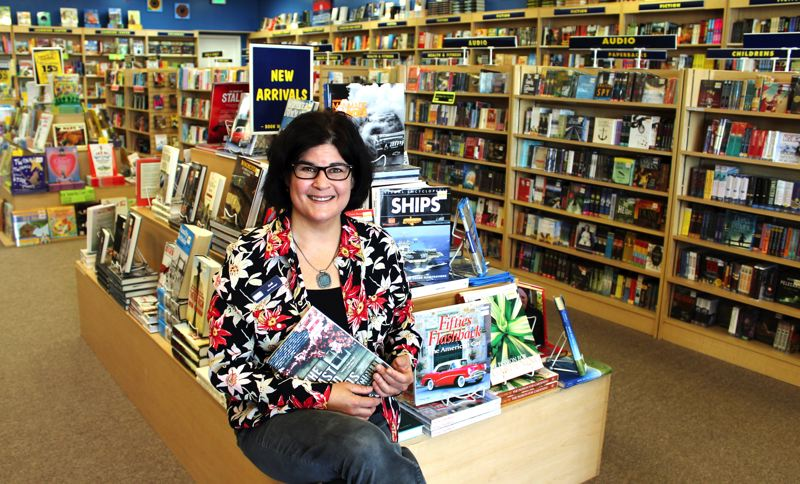 by: OUTLOOK PHOTO: ANNE ENDICOTT - Jodi Fulmer, manager for the Troutdale Book Warehouse, says there is still a place for book stores in the community and a book for every personality. The Tennessee-based company underwent some financial reorganization and has reopened 23 stores nationwide, two in Oregon.