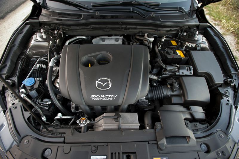 by: JOHN M. VINCENT - Two engines are available: a Skyactiv-G 2.0-liter inline 4-cylinder or a Skyactiv-G 2.5 liter inline-4.