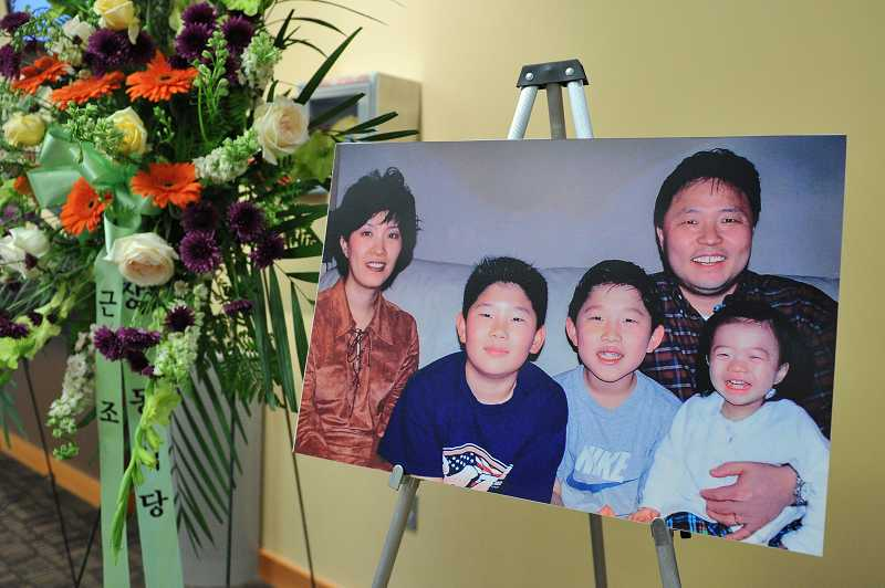 by: TIMES PHOTO: JOHN LARIVIERE - A Lee family photo was among the memorabilia on display the lobby of the Beaverton Village Baptist Church, where a memorial service for Paul Lee was held on Sunday.