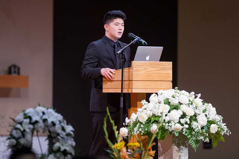 by: TIMES PHOTO: JOHN LARIVIERE - Albert Lee, older brother of Paul Lee, who was slain by a gunman at Seattle Pacific University on Sunday, shares memories of Paul during the memorial service.