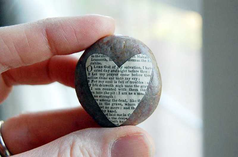 by: PHOTOS COURTESY OF FACEBOOK.COM/LOVEDRENCHED - This particular Love Rock captures the bittersweet mix of joy, love and desolation that can all be part of grieving the loss of a beloved child. The comforting, heart-shaped symbol of love is made from the words of Psalm 88: O lord God of my salvation, I have cried day and night before thee  For my soul is full of troubles  Thou hast laid me in the lowest pit, in darkness, in the deeps. Thy wrath lieth hard upon me, and thou hast afflicted me with all thy waves.