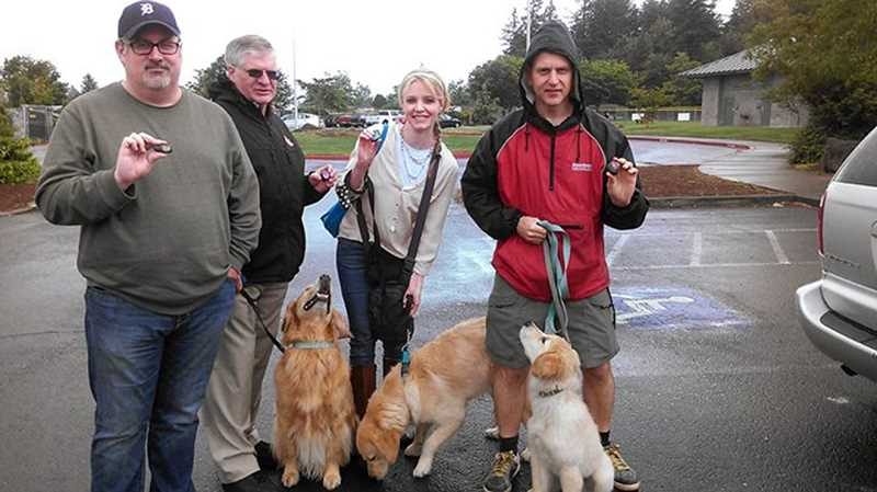 Tom Robinson (far right, with puppy Linus) couldnt imagine a better way to celebrate Fathers Day this year than by spreading Love Rocks -- and Abigails and Annas love -- through a grieving Troutdale and West Linn.