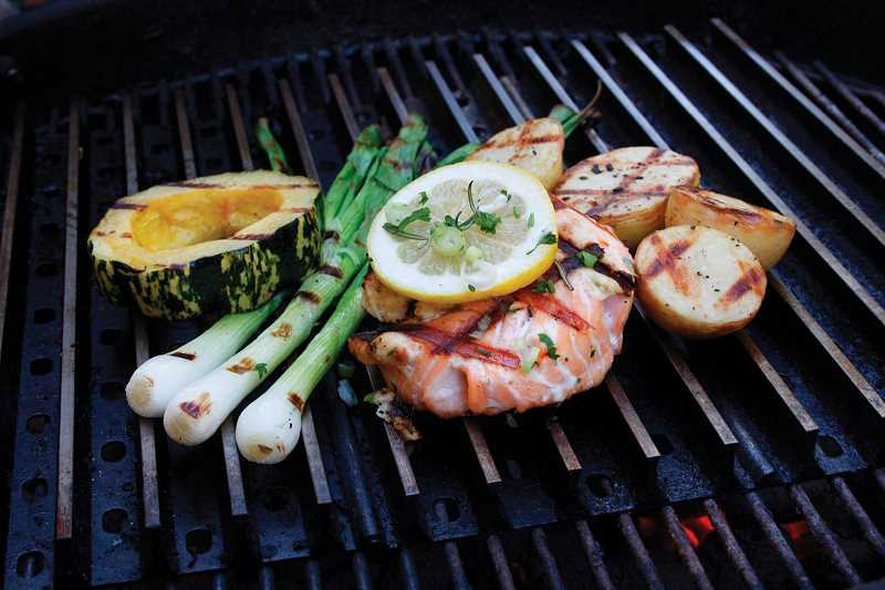 by: SUBMITTED PHOTOS: GRILLGRATE.COM - This Salmon with Lemon Caper Butter was made on GrillGrates. Notice the bold sear marks on the foods.