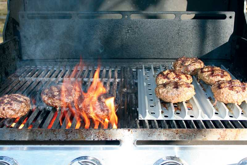 This photo illustrates how the raised rail design of GrillGrates prevent flare ups, which cause foods to char. The food on the left is cooking on a conventional grill, the food on the right is cooking on GrillGrates.