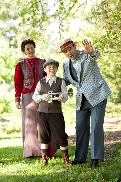 by: SUBMITTED PHOTO - Joe Theissen as Prof. Harold Hill, encourages a boy to join the boys band while Marian the librarian, played by Chrissy Kelly-Pettit.