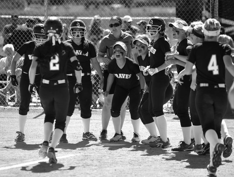 by: NEWS-TIMES PHOTO: ZACK PALMER - Banks softball players celebrate at home plate after MaKenna Partain (2) hit a home run in the state semifinals against Henley.