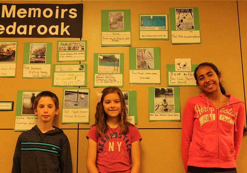 by: TIDINGS PHOTO: KATE HOOTS - From left, fifth-graders Joseph Kearney, Alexis Walker and Carmen Henry  Buckley pose with their six-word memoirs at Cedaroak Primary School. They worked with student teacher Tori Hamachek to use six words and a photo to capture a special Cedaroak memory before they head to middle school next fall.