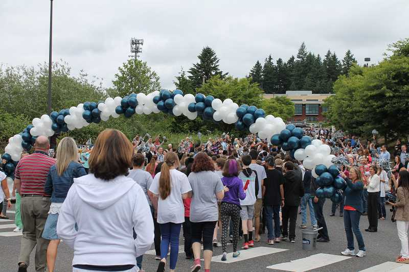 by: THE REVIEW: JILLIAN DALEY - Hundreds of students, relatives and employees from Lake Oswego junior high and high school attended the Balloon Crossing.