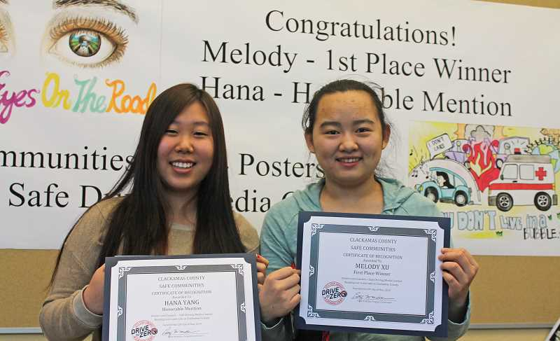 by: THE REVIEW: JILLIAN DALEY - Lake Oswego High had two honorees in the Clackamas County Safe Communities Posters and Coasters Safe Driving Media Contest. From left: Hana Yang, honorable mention; and Melody Xu, first place.