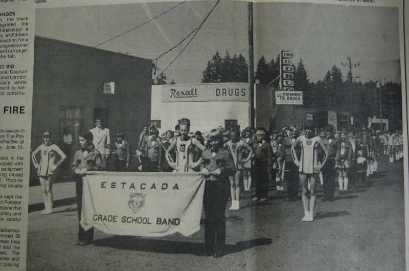 by: ARCHIVE PHOTO - The caption to this 1974 photo reads: 'The Estacada Grade School Band paused for the photographer after demonstrating their skills to Estaacada merchants and observers. The band marched through stores, drums beating and horns blaring in prepartion for their annual trip to Portland to play in the Junior Rose Festival Parade.'